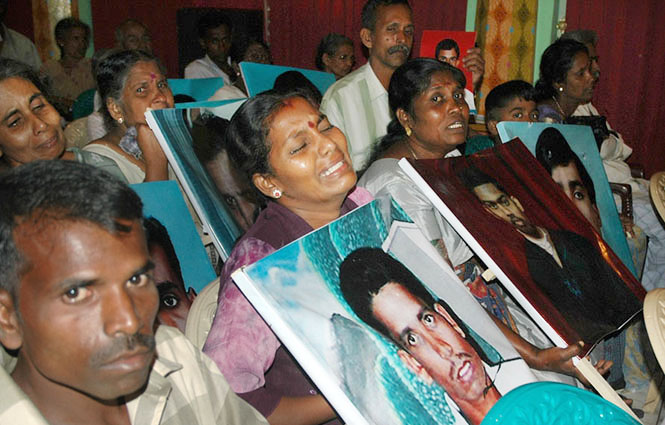 Relatives Of Abducted Civilians Cry While Holding Pictures Of Their Loved Ones During A Meeting Of The Civil Monitoring Committee In Colombo In April 2007